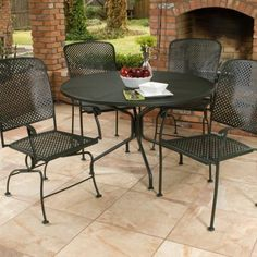 Woodard Fullerton Outdoor Dining Set by Woodard. $1151.99. The Woodard Fullerton Outdoor Dining Set is the perfect recipe for easy entertaining. Crafted with durable wrought-iron hand-formed from solid iron stock, this traditional outdoor set includes a generous round table for four and your choice of comfortable chairs - pick four coil spring chairs, four stationary dining chairs, or two of each.Above the table's sturdy base, the micro mesh tabletop easily withstands...