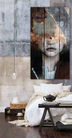 Huge artwork and distressed plasterwork characterise this loft / warehouse bedroom