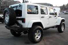 2015 Jeep Wrangler Unlimited with 2 inch MOPAR lift, 33
