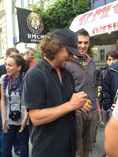 Eddie Vedder writes fans' request on his cigarette pack----of course he is!! He's Eddie Vedder!!