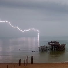 Lightning at Brighton with the old West Pier. Photo by Damian Andrusievicz Brighton East Sussex, Brighton England, New Brighton, Brighton And Hove, Best Places To Live, Natural Phenomena, Old West, Great Pictures, East Coast