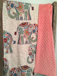 Adorable stylish karavan elephant blanket made of high quality cotton and backed with luxuriously soft coral minky on the back. Topstitched