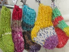 Knitted teeny socks for the keyhanger.