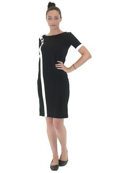 Straight black jersey dress. The front is decorated with white cant.