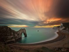 Chilly winter sunset at Durdle Door, a Portland Stone arch on the Jurassic Coast. Jurassic Sunset by n hasshim on 500px