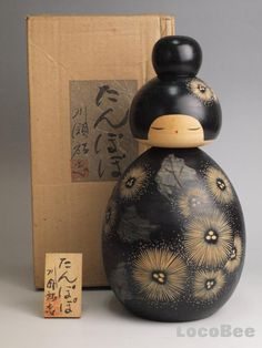 """This is Japanese Sosaku Kokeshi doll design by Kawase Yuji.This title is Tanpopo,meaning a dandelion."""