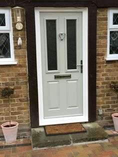 Composite front door in similar colour to Farrow & Ball French Grey (RAL with heart door knocker Grey Composite Front Door, Grey Front Doors, Front Door Colors, Front Door Decor, Porch Doors, House Doors, Windows And Doors, Entry Doors, Entrance