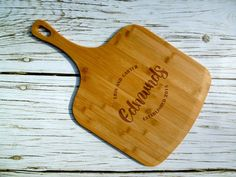 Personalozed pizza peel. Custom pizza gift. Etsy listing at https://www.etsy.com/listing/267973208/last-name-custom-pizza-peel-bamboo-laser
