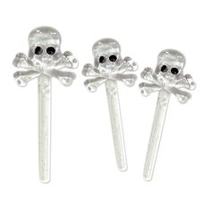 "Skull Picks (12).  Turn your snacks scary with these plastic skull picks! Use them to dress up Halloween cupcakes or other ""bootiful"" baked treats. Set the scene at a pirate or a murder mystery themed party table.  7.62cm; set of 12; molded plastic. accessories not included"