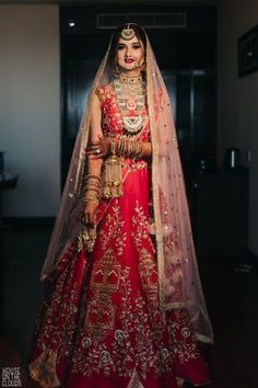 Traditional red bridal lehenga with temple embroidery design for wedding. Mehendi Outfits, Indian Bridal Outfits, Indian Bridal Lehenga, Indian Bridal Fashion, Bridal Dresses, Designer Bridal Lehenga, Lehenga Designs, Dress Indian Style, Indian Dresses