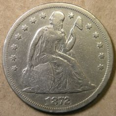 1872 Liberty Seated Dollar.  This silver coin was minted 1840 - 1873.  It fell out of circulation from 1853-1870 (due to value of silver being worth more than a buck). Returned 1870 until 1873.