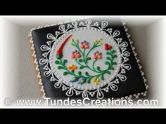 decorated with royal icing by gingerbread artist Tunde Dugantsi. For more information about these cookies and to see other…