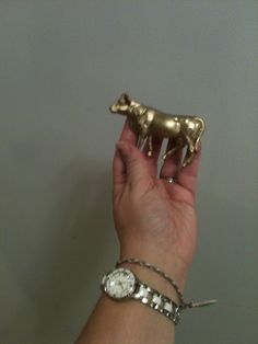 Plastic toy cow spraypainted gold for Golden Calf :o)