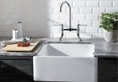 Traditional designs for modern homes with BLANCO: our BLANCO Belfast sink perfectly teamed with the BLANCO VICUS BRIDGE Twin Lever tap in Chrome
