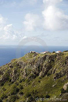 Typical houses on cliff mountain over Caribbean Sea Saba Dutch Netherlands  Antilles