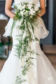 gardenia bridal bouquet. gorgeous gardenia feature stems: white gardenias, sea holly, cascade of plumosa fern and pearls