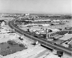 Las Vegas strip in 1958, north of Flamingo, looking further north towards Sands. Some dusty motels - Sage & Sand, Flamingo Capri, Pyramids Motel, Tumbleweed Motel. Caesars Palace shops, O'Sheas, Quad and Harras exist here in 2013.