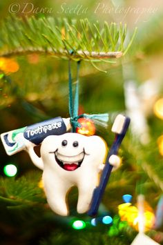 Tooth ornament. Moore Pediatric Dentistry - pediatric dentist in Roseville, CA @ moorepediatricdentistry.com
