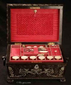 A sewing box of impressive form, decoration and workmanship, the interior lined with red silk and fully fitted with mother of pearl sewing tools, Circa 1825.