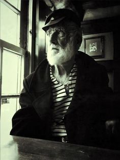 low light UK pub portrait of old sailor with black and white effect using Snapseed app and Pocket Tripod iPhone stand