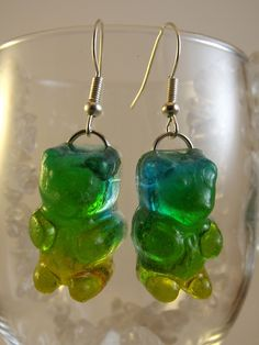 """Tri-color Gummy Bear Earrings complete with earwires. The colors fade from Blue to Green to Yellow. These adorable Gummy Bears are 1"""" long 1/2"""" wide. They are created with a two part epoxy resin. This type of coloration takes two different pours each one needing at least 24 hours to properly cure..."""