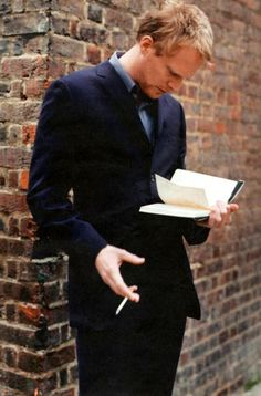 A real man reads standing up...  (Or even, a real man, reads...)