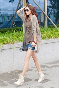 Brown top with cardigan and denim shorts and cream wedges. Casual shopping outfit.