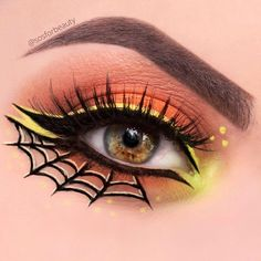 @sosforbeauty getting us geared up for Halloween with our Noir Fairy Lashes and this candy corn inspired makeup look!