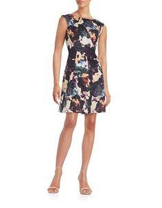 """<ul> <li>Charming florals in a unique, pleated design</li> <li>Boatneck</li> <li>Cap sleeves</li> <li>Back zipper closure</li> <li>Pleated details</li> <li>About 36"""" from shoulder to hem</li> <li>Polyester/spandex</li> <li>Machine wash</li> <li>Imported</li> <li>This item will arrive with a tag attached and instructions for removal. Once tag is removed, this item cannot be returned.</li> </ul>"""