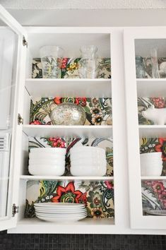 Image result for cabinets with wallpaper