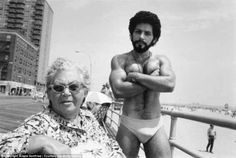 This photograph shows a man named Angel, showing off as a woman gives a stern…
