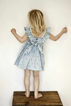 """I know this picture is meant to showcase this kid's dress, but it just reminds me of a really creepy """"time out."""""""
