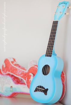 (I originally shared this fun tutorial over on the Fabricworm blog )  Last summer by husband bought each of my girls a ukulele. He plays ...