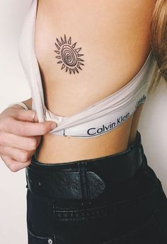 Sun Flower Rib Tattoo Ideas for Women - Floral Flower Side Boob Tat at MyBodiArt.com