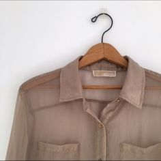 Gold Sheer Michael Kors blouse Light spot on bottom right-hand corner of shirt see last picture . Buttons on both arms missing MICHAEL Michael Kors Tops Blouses