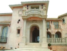 Gorgeous Spanish Colonial in pink stucco :: Cast Stone Entry w/ Columns & Balustrade by American Masonry Supply, Inc.