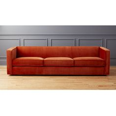 Shop Club 3-Seater Rust Velvet Sofa.   For stretching out solo or hanging with a crowd, our longest sofa yet makes room for four.  Sheltering club suits up in a luxe rust velvet, tailored with exaggerated flange that outlines streamlined design.