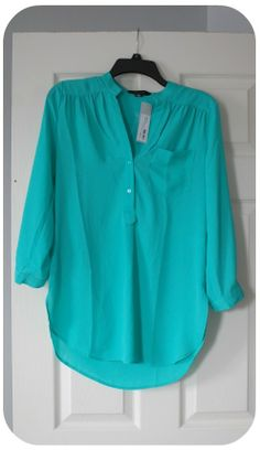 Stitch Fix Colibri Solid Tab Sleeve Blouse by 41Hawthorn  Similar to the color (which I loved) of the tank I sent back last time, but possibly a better fit/style for me