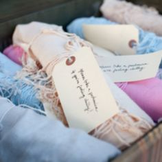 A reception in the woods can get cold when the sun sets. For a practical and usefully adorable party favor give your guests a small blanket to wrap around themselves.
