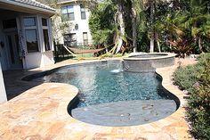 Small swimming pool in tiny yard.