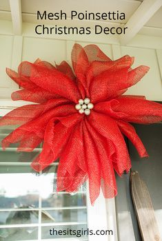 DIY mesh poinsettias are great Christmas decor because you can hang them inside or outside and customize the colors to match your Christmas style.  via @swaywithsway