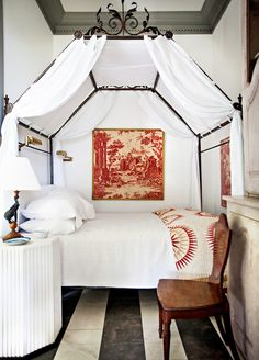 If this space were our guest bedroom for a weekend, we might never leave. With an iron canopy bed, sophisticated toile, and classic antique furniture, it's the epitome of European elegance.