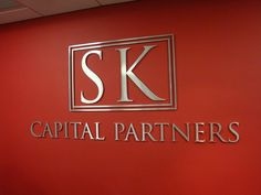 Satin aluminum metal letters pin mounted with standoffs onto painted wall in NYC.  We specialize in custom interior and exterior signs in New York, NY. Visit our website below to contact us for a free consultation! http://www.SignsVisual.com
