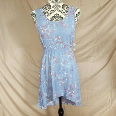 High Low Open Back Dress Brand new with tags. Size Small by Charlotte Russe. Elastic around the waist. Open back. High low bottom. Gorgeous blue/purple color with floral print. Lowest price!!! Charlotte Russe Dresses High Low