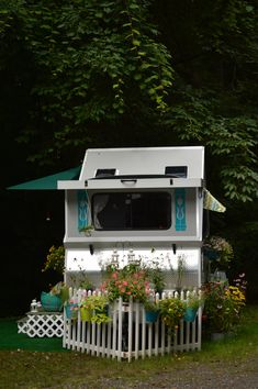 Love the picket fence...2014 Chalet XL 1935...sweet!  click on link to see the inside pics - this is not stationary, but at a campground.  wow.  She has a great outside kitchen setup