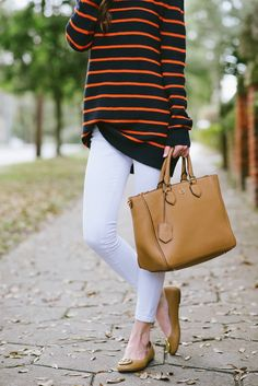 White skinny jeans, Striped oversize sweater, Tory Burch Purse and Reva Flats