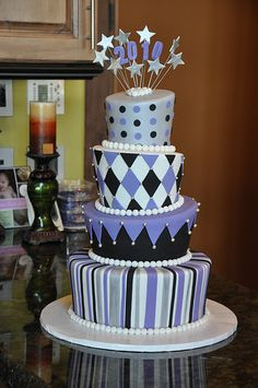 topsy turvy graduation cake...maybe in crimson, gold, black, & white