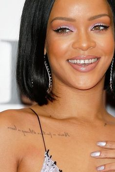 """Rihanna's charcoal-grey collarbone ink reads, """"Never a failure, always a lesson — but backwards, so she can read it in the mirror"""