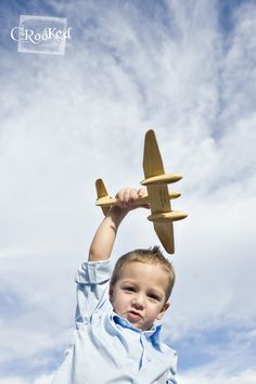 Little Boy Shoot with his plane  Photo By www.crookedphotography.com I like the angle and the sky in the background