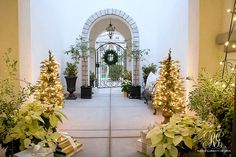Silver and gold Christmas decor on front porch / courtyard